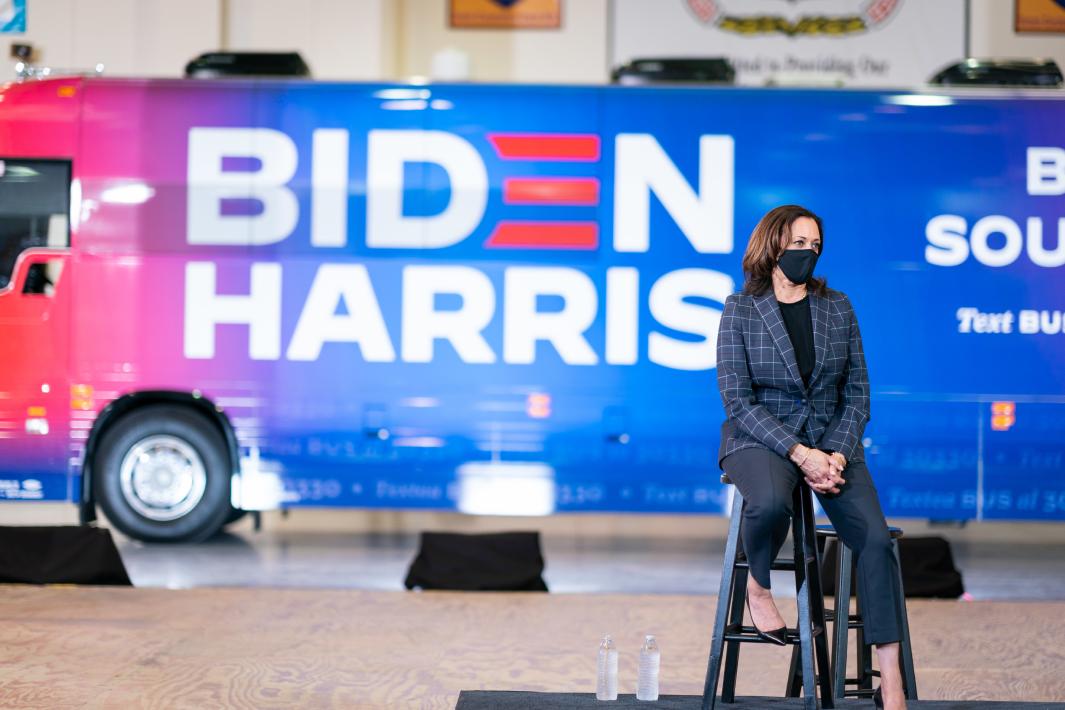 VP Kamala Harris sitting in front of Biden/Harris bus